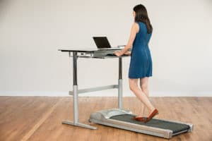 buyer a exercising exercise woman cycles under guide watching elliptical desk computer while her s at best screen